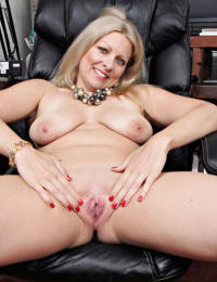 Hot over 50 MILF Zoey Tyler undressing and spreading pink pussy