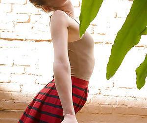 Ravishing redhead amateur Julie Wheeler in like manner off her ass outdoors