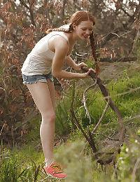 Pigtail wearing redhead teen Wendy Patton having fun exposing herself