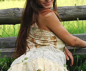 European glamour model Sofi A revealing perfect breasts in country field