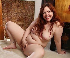 MILF fatty Ember Rayne strips for masturbation of hairy vagina
