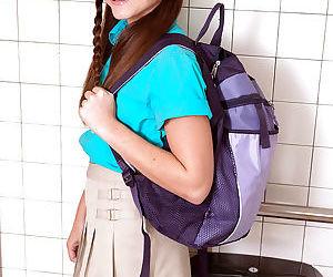 Young girl Kharlie Stone pulling down schoolgirl panties to pee in toilet